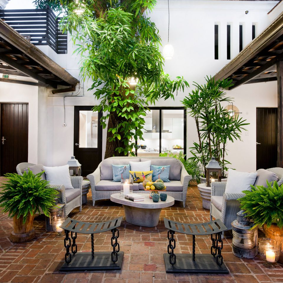 Boutique Courtyard Historic Hotels Lounge Outdoors Patio property home building living room house porch plant backyard outdoor structure condominium cottage farmhouse Villa mansion