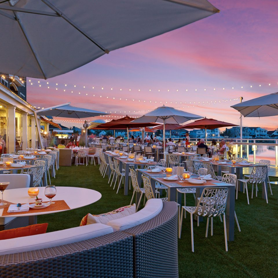 Boutique Dining Drink Eat Modern Scenic views Sunset Waterfront umbrella chair lawn Resort restaurant vehicle set function hall accessory Deck shore dock