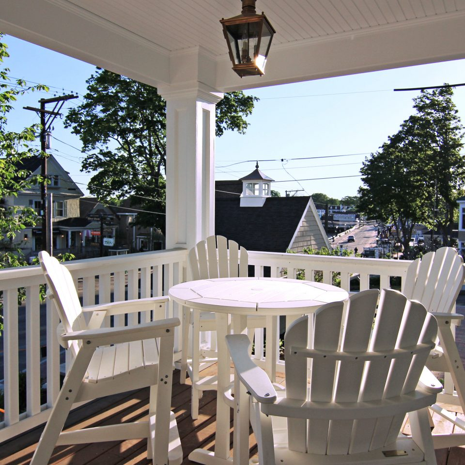 Boutique Deck Inn Romance Romantic Waterfront chair tree porch property building home Dining white house cottage outdoor structure Villa Resort backyard restaurant dining table