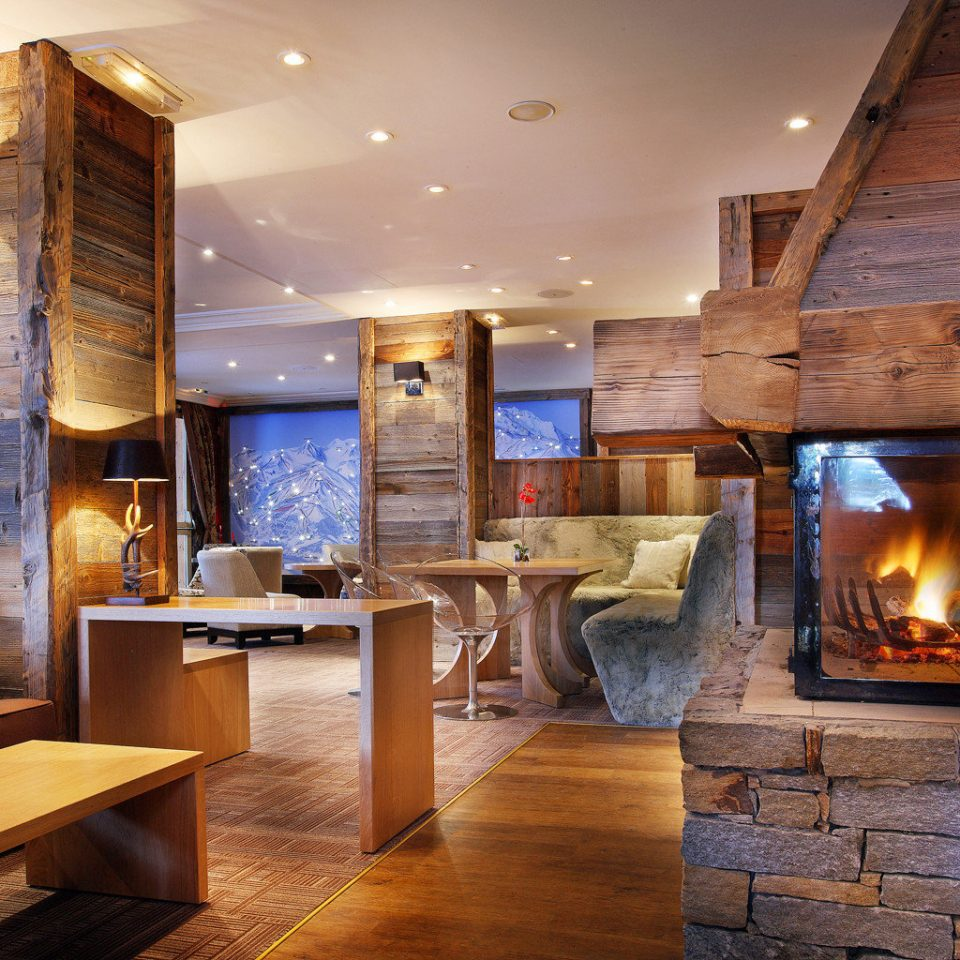 Boutique Drink Fireplace Lobby Lodge Lounge Mountains fire home living room hardwood hearth lighting cottage wood flooring stone