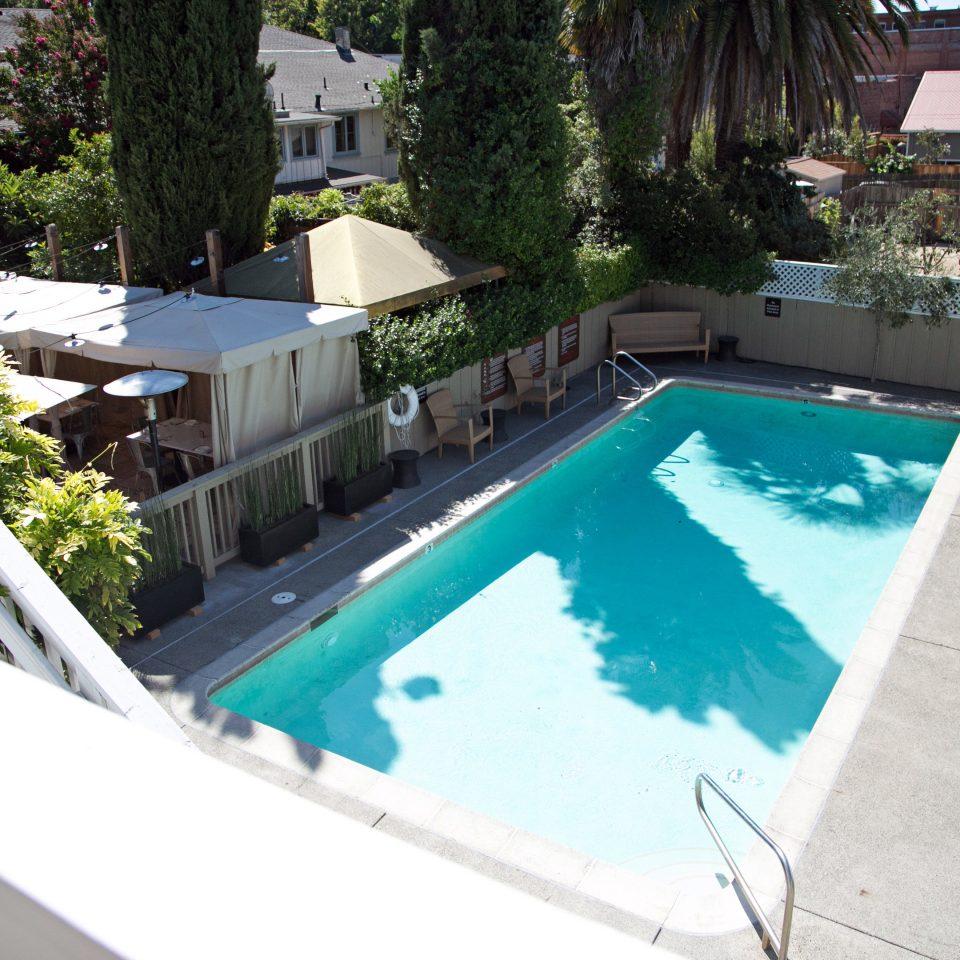 Boutique Eco Lounge Outdoors Pool tree swimming pool property building backyard Villa Resort condominium ramp