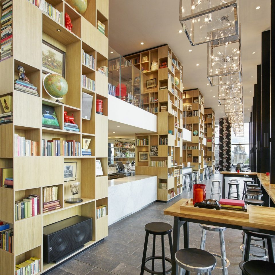 artistic artsy books Boutique charming contemporary cozy decor Elegant fancy Hip homey interior library living area living room Lounge Luxury Modern natural light regal sophisticated Style + Design stylish trendy windows shelf building bookselling retail