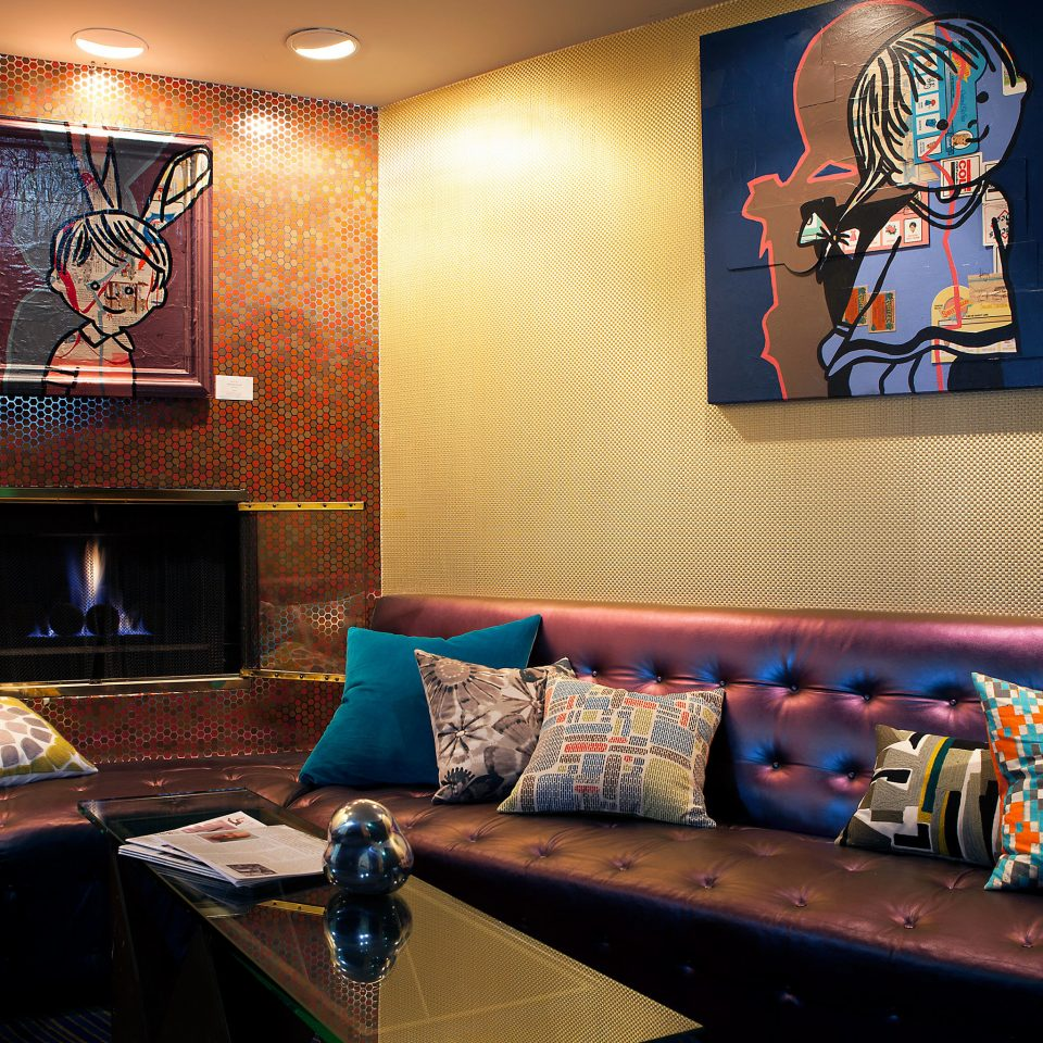 Boutique Fireplace Hip Lobby Lounge living room recreation room home Suite sofa seat colorful colored