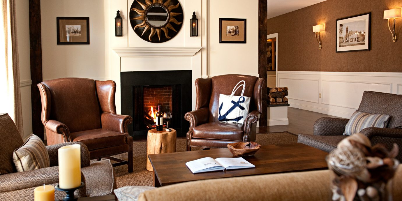 Boutique Fireplace Lobby Modern sofa living room property home hardwood Suite cottage recreation room