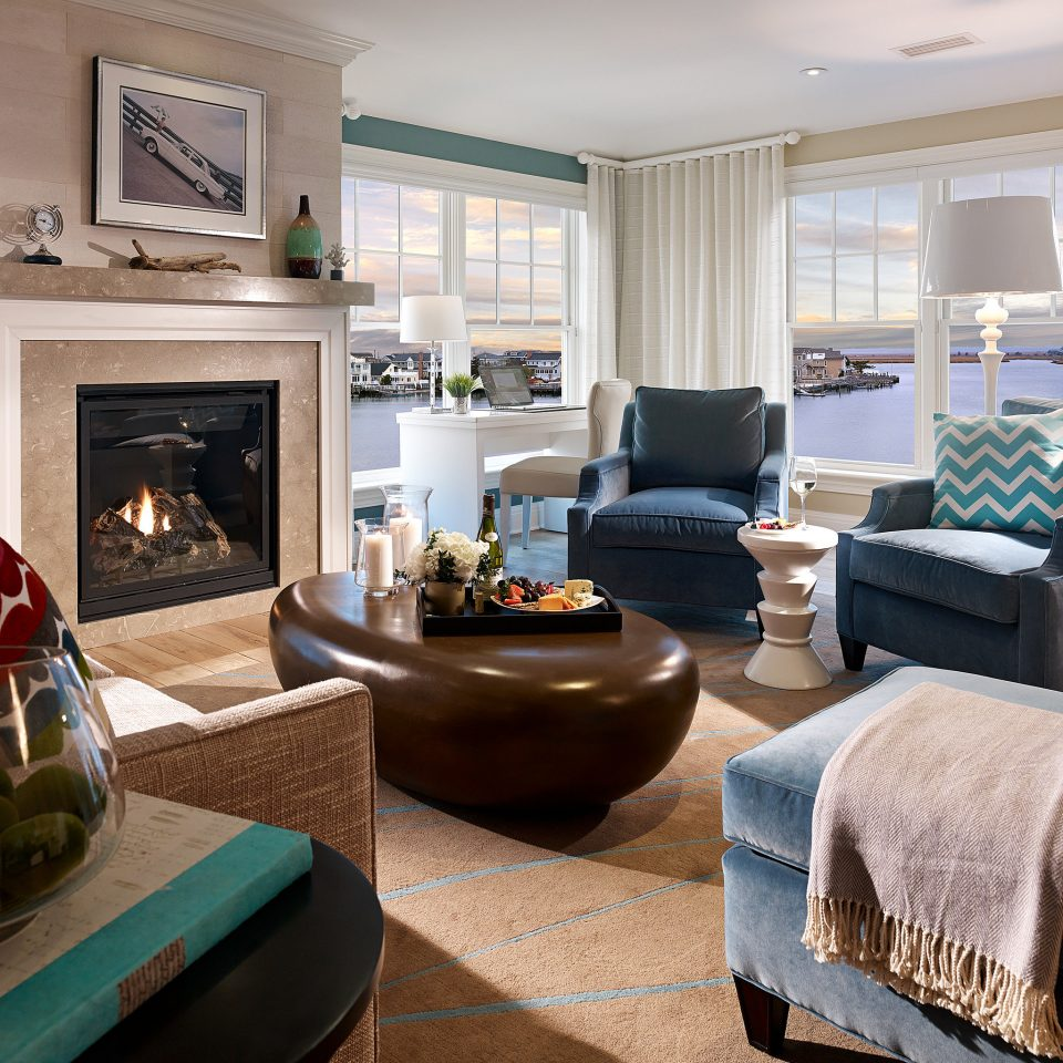 Boutique Fireplace Lounge Modern Scenic views Waterfront living room property home hardwood Suite cottage condominium flooring