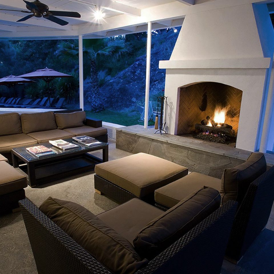 Boutique Fireplace Lounge Natural wonders Romance Wellness sofa property living room house home Villa mansion stone