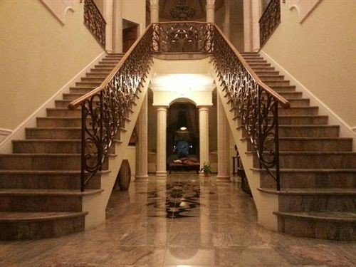 Boutique Grounds Waterfront building stairs property chapel step mansion place of worship aisle Lobby stone stair basement