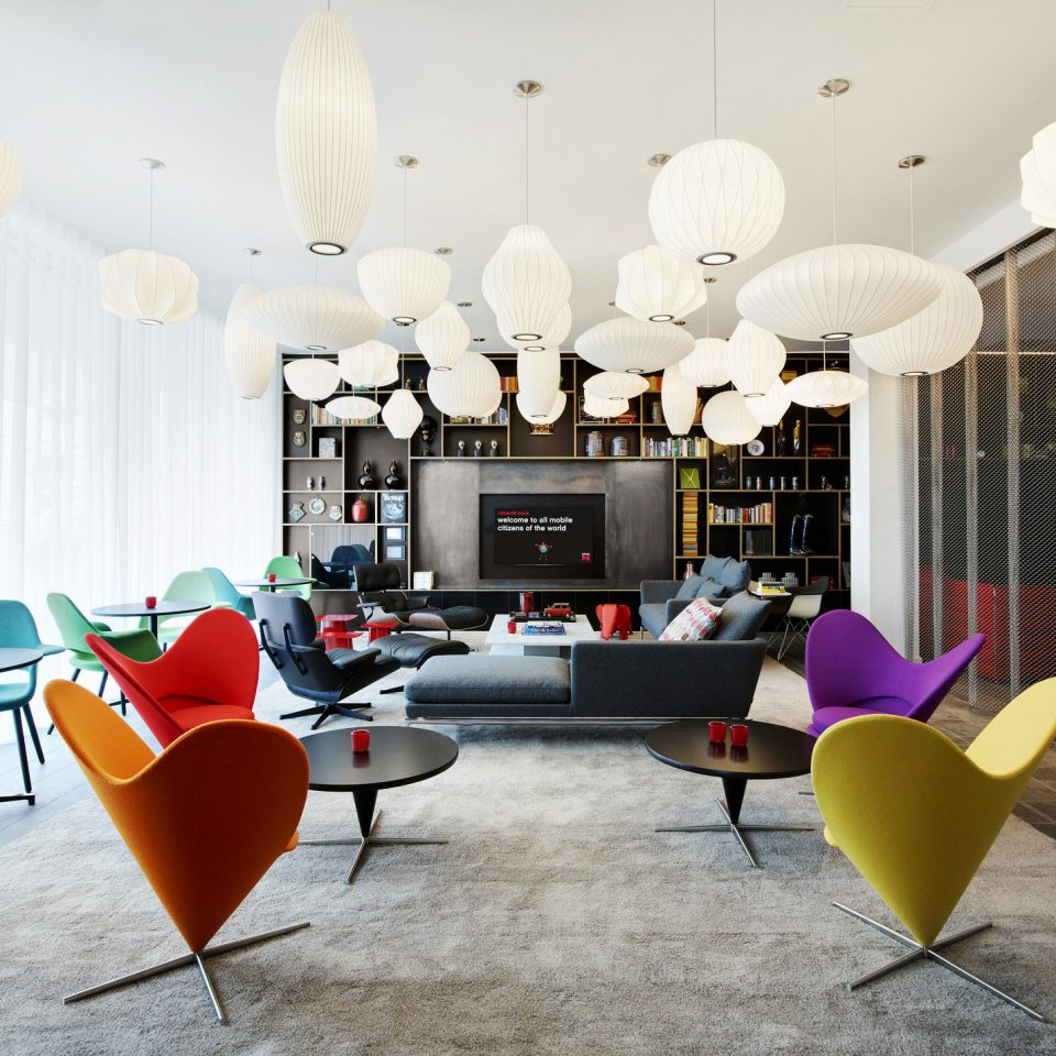 artistic artsy Boutique contemporary Hip interior living area living room Lounge Modern natural light Style + Design stylish trendy windows color chair Lobby lighting