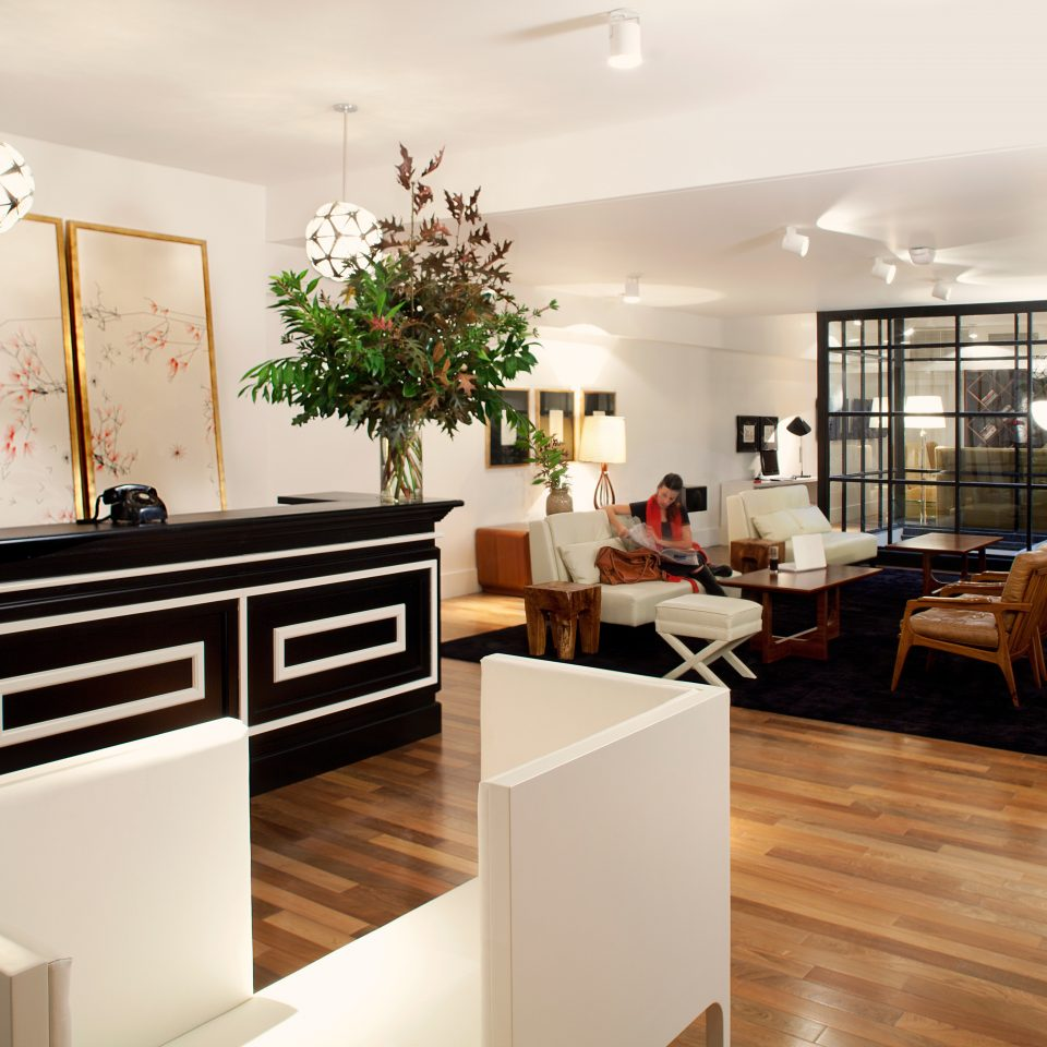 Boutique Hip Lobby Modern property hardwood home living room wood flooring cabinetry flooring