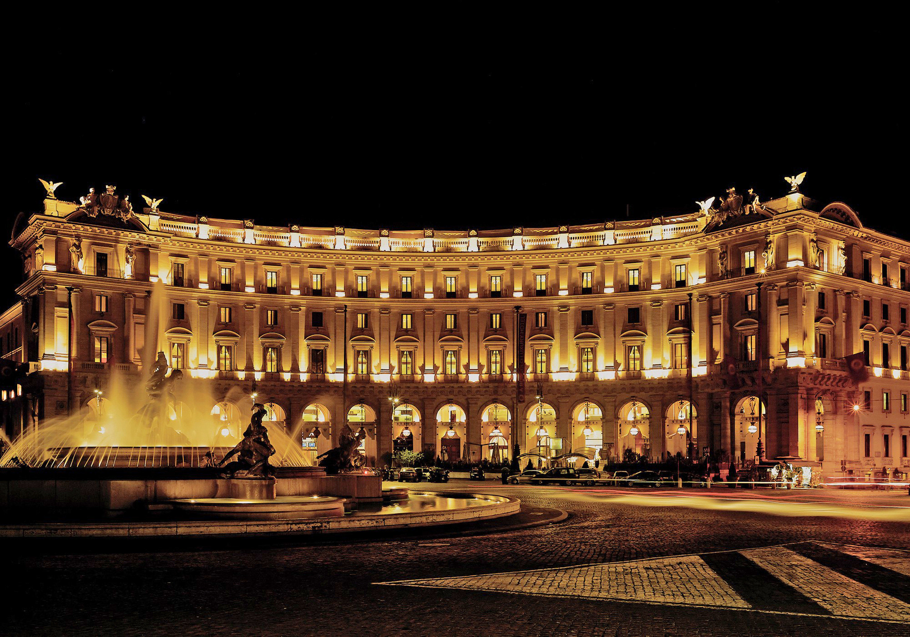 Boutique Hotels City Elegant Grounds Italy Luxury Luxury Travel Romantic Hotels Rome night landmark lit plaza palace metropolis evening opera house light cityscape town square ancient history government building