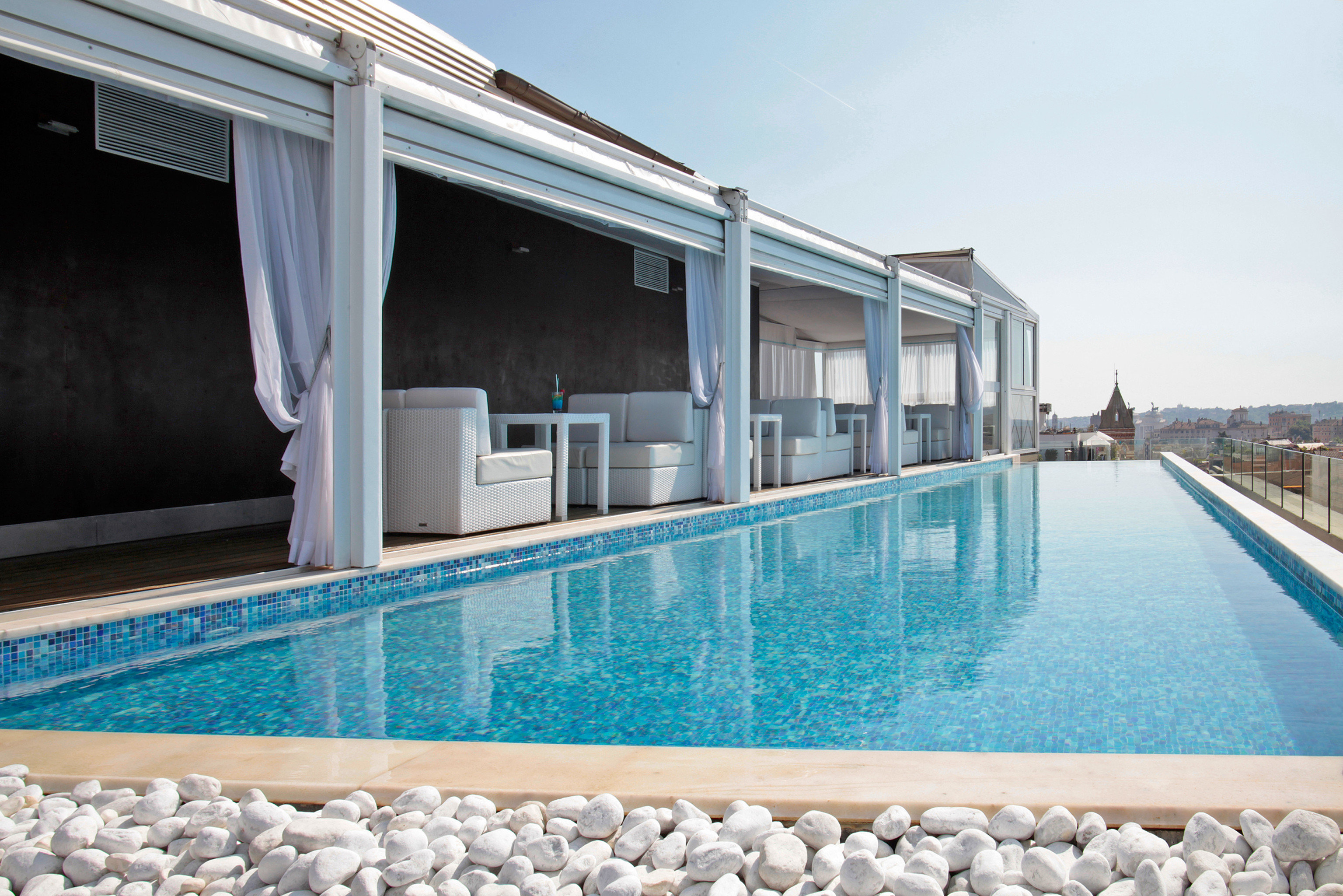 Boutique Hotels City Elegant Italy Luxury Luxury Travel Pool Romantic Hotels Rome Rooftop sky swimming pool property leisure blue Villa Resort home condominium