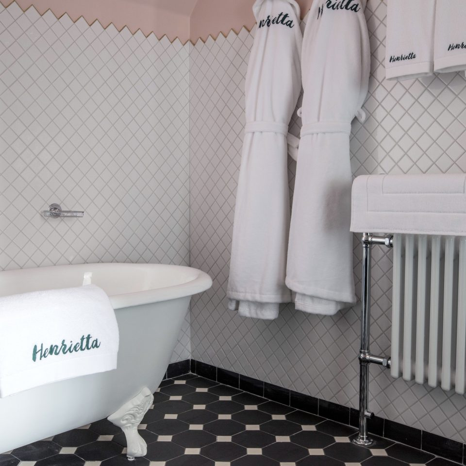 Boutique Hotels Hotels bathroom property tile purple product toilet toilet seat plumbing fixture flooring tap product design bathroom accessory bidet sink public toilet ceramic towel tiled