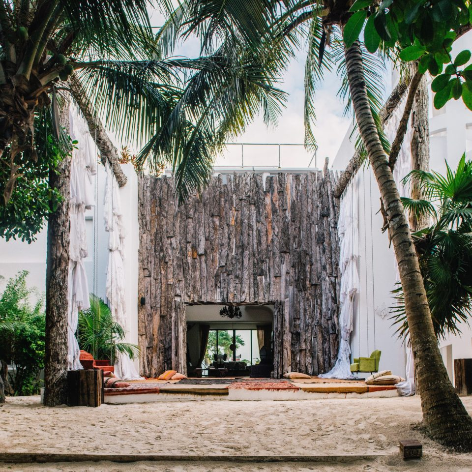 Boutique Hotels Hotels Mexico Tulum arecales palm tree tree plant tourist attraction hacienda building