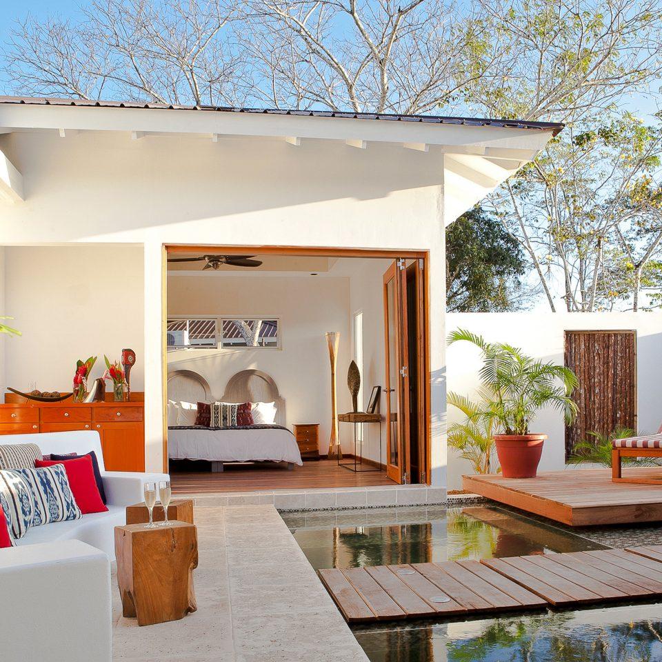 Boutique Hotels Patio Resort Suite property home house living room Villa backyard outdoor structure cottage farmhouse porch