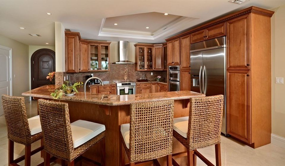 Boutique Modern Waterfront Kitchen chair property cabinetry home cottage hardwood cuisine classique Suite appliance Island