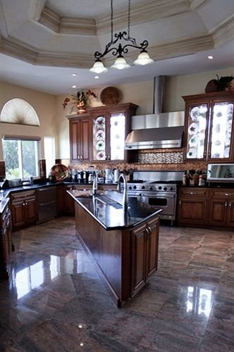 Boutique Kitchen Waterfront property countertop home cabinetry hardwood cuisine classique mansion wood flooring cottage farmhouse flooring living room hard appliance stainless Island