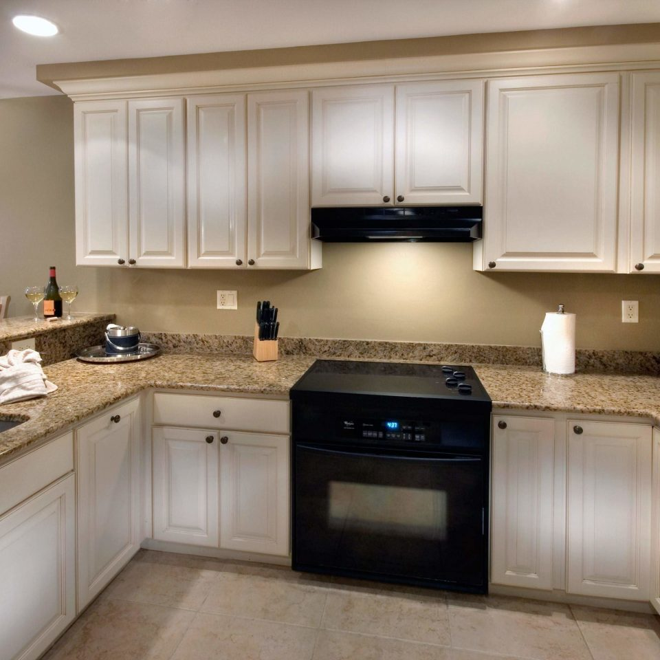 Boutique Kitchen cabinet property countertop cabinetry home cuisine classique hardwood counter appliance material steel stainless kitchen appliance stove silver