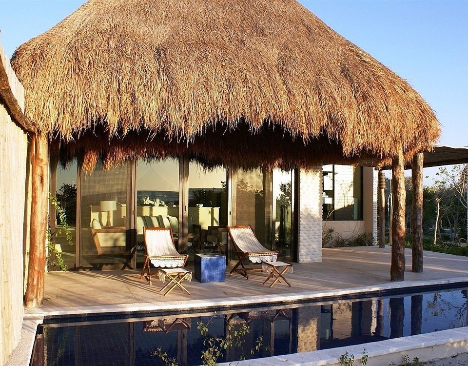 Boutique Lounge Modern Patio Pool Tropical sky roof property building thatching house hut gazebo cottage home Villa outdoor structure restaurant farmhouse material