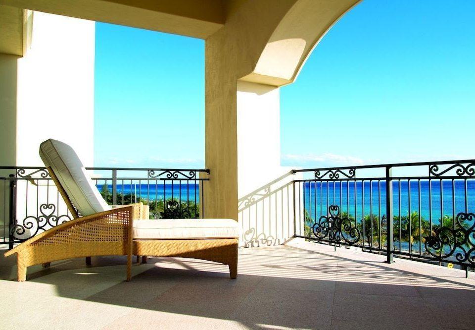 Boutique Modern Ocean Patio Scenic views Waterfront building property chair Villa condominium home handrail Resort overlooking