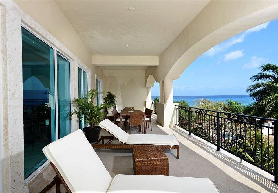 Boutique Modern Patio Waterfront building property condominium Villa home Resort mansion swimming pool porch colonnade
