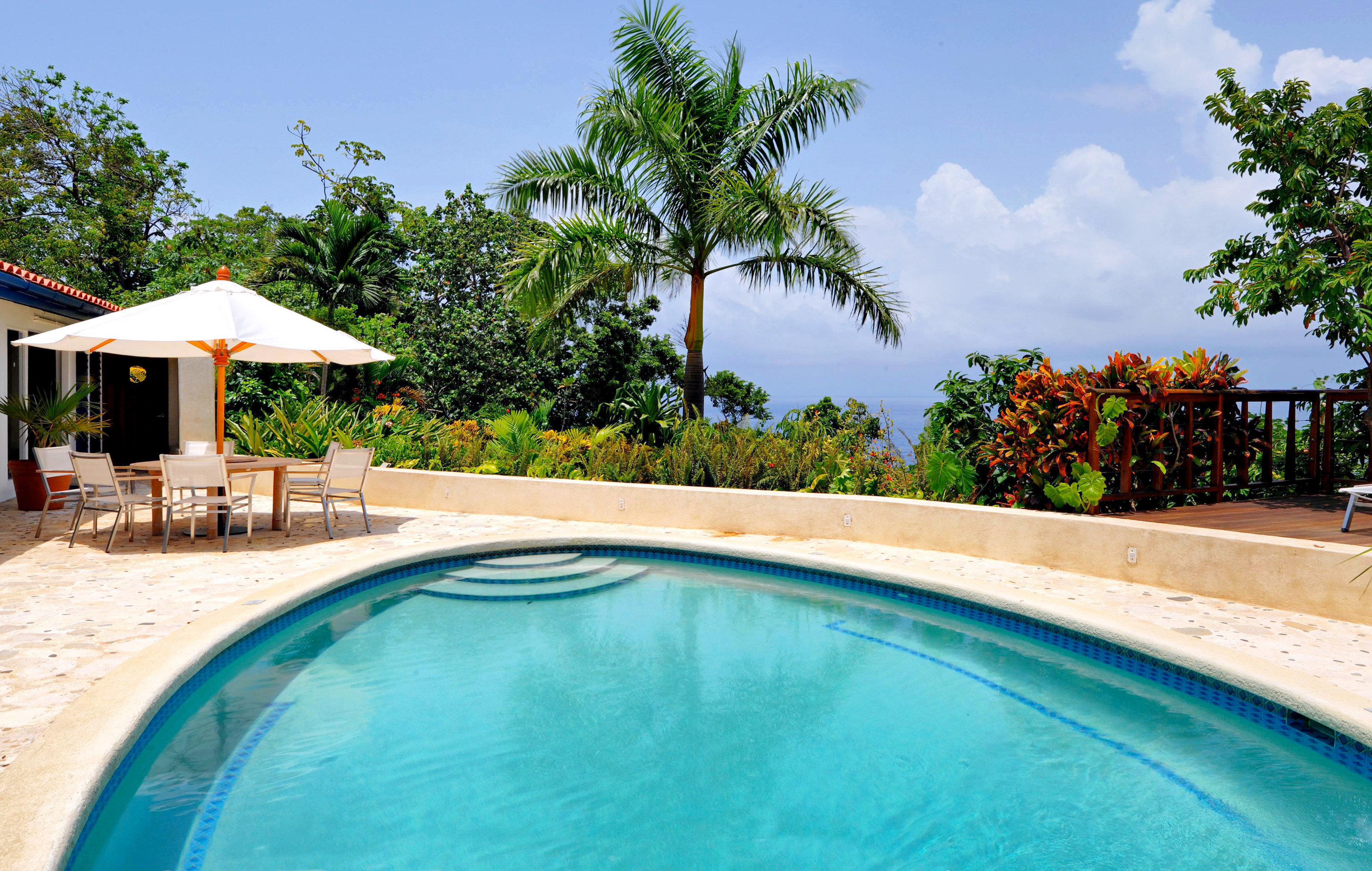 Boutique Pool Scenic views Tropical Waterfront sky tree swimming pool property leisure Resort Villa swimming caribbean backyard