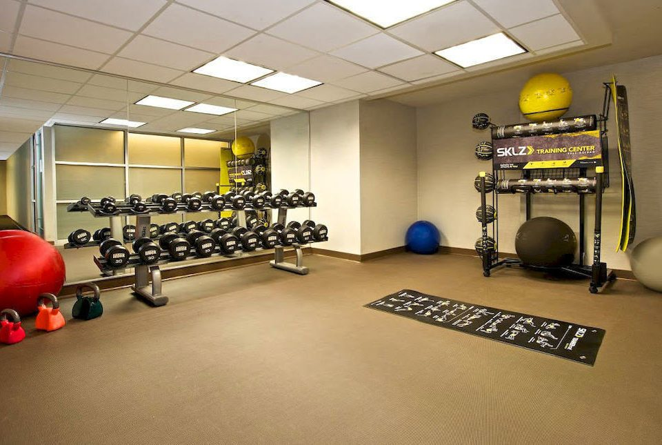 structure gym desk sport venue recreation room office boxing ring flooring equipment cluttered