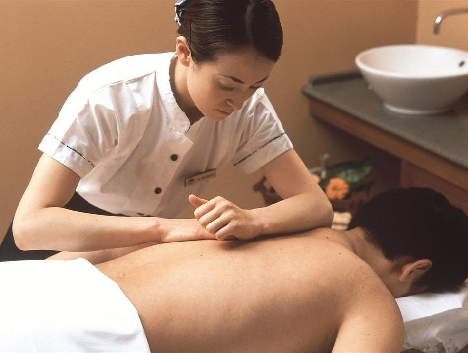sitting boy male young therapy muscle massage