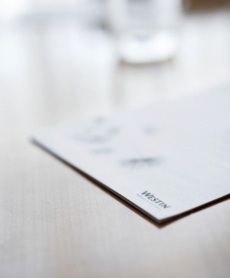 white close up writing brand shape document hand