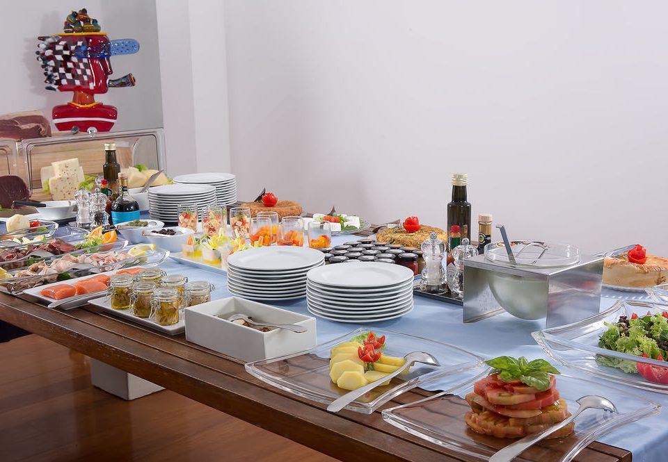 food plate counter breakfast buffet brunch vegetable meat cluttered