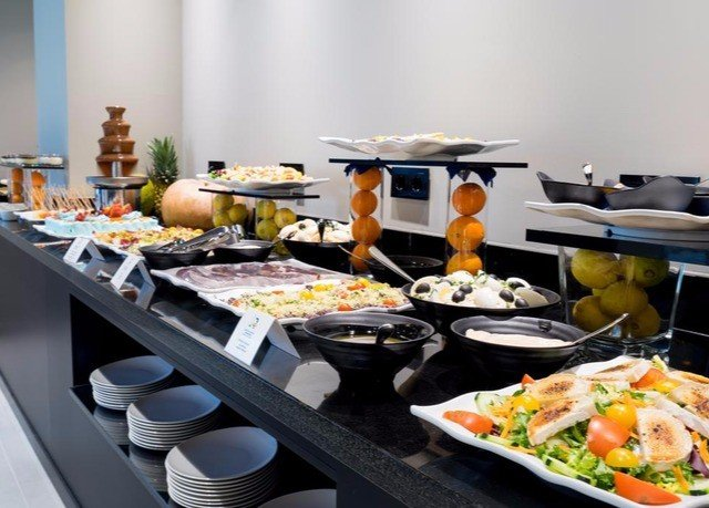 food buffet brunch breakfast cuisine counter lunch restaurant dining table