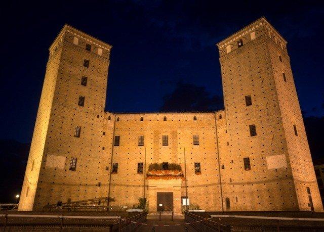building tower sky brick tall lit night castle château
