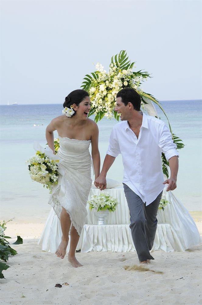 sky photograph bride man woman wedding wedding dress groom ceremony bridal clothing gown sandy