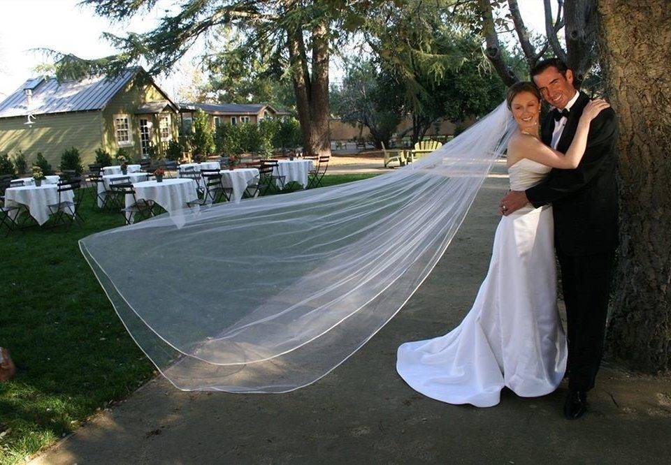 tree grass bride wedding ceremony groom dress gown veil posing