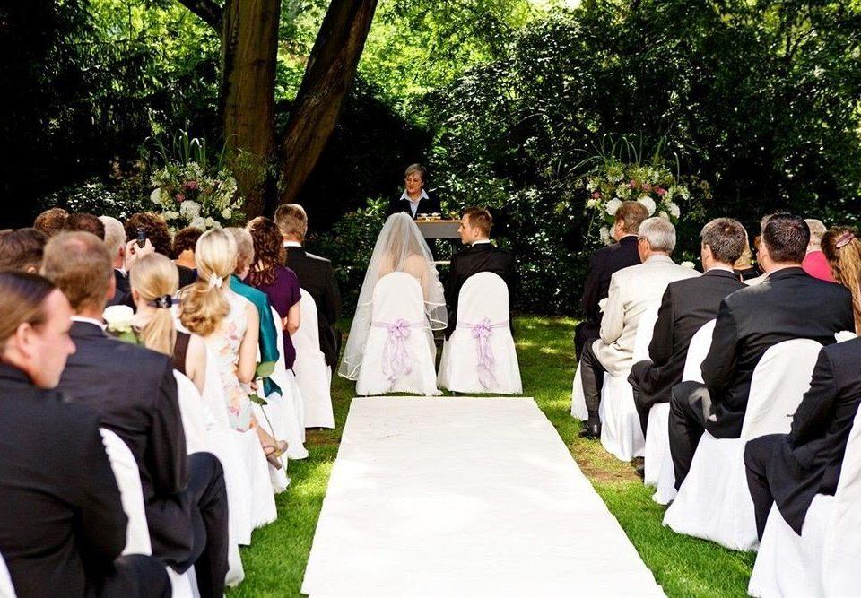 tree grass wedding ceremony group groom bride marriage wedding reception