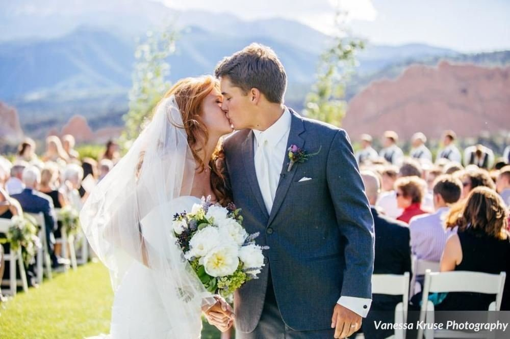 mountain man bride standing ceremony groom wedding suit marriage