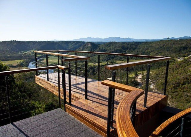 sky mountain property building walkway bridge outdoor structure overlooking