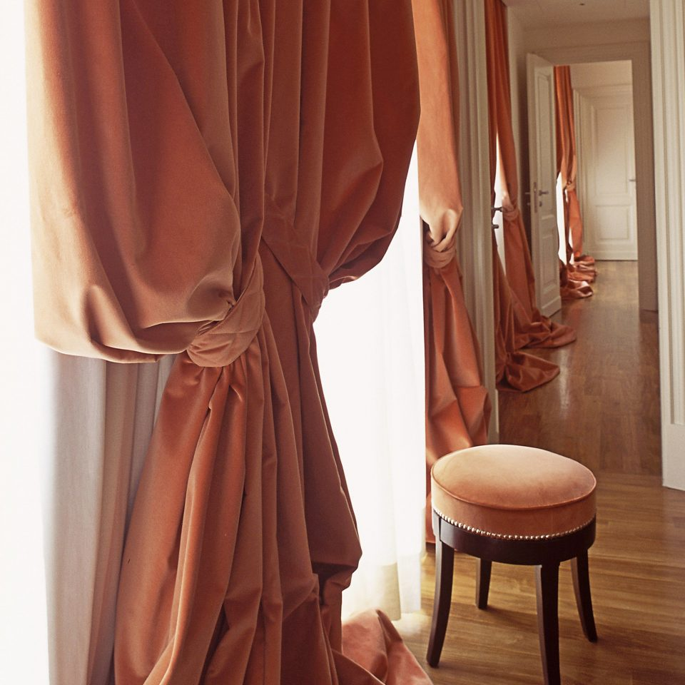 curtain clothing brown gown dress textile formal wear outerwear material window treatment clothes