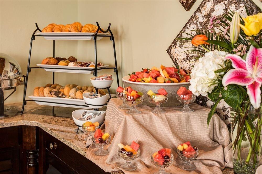 floristry buffet brunch food cluttered
