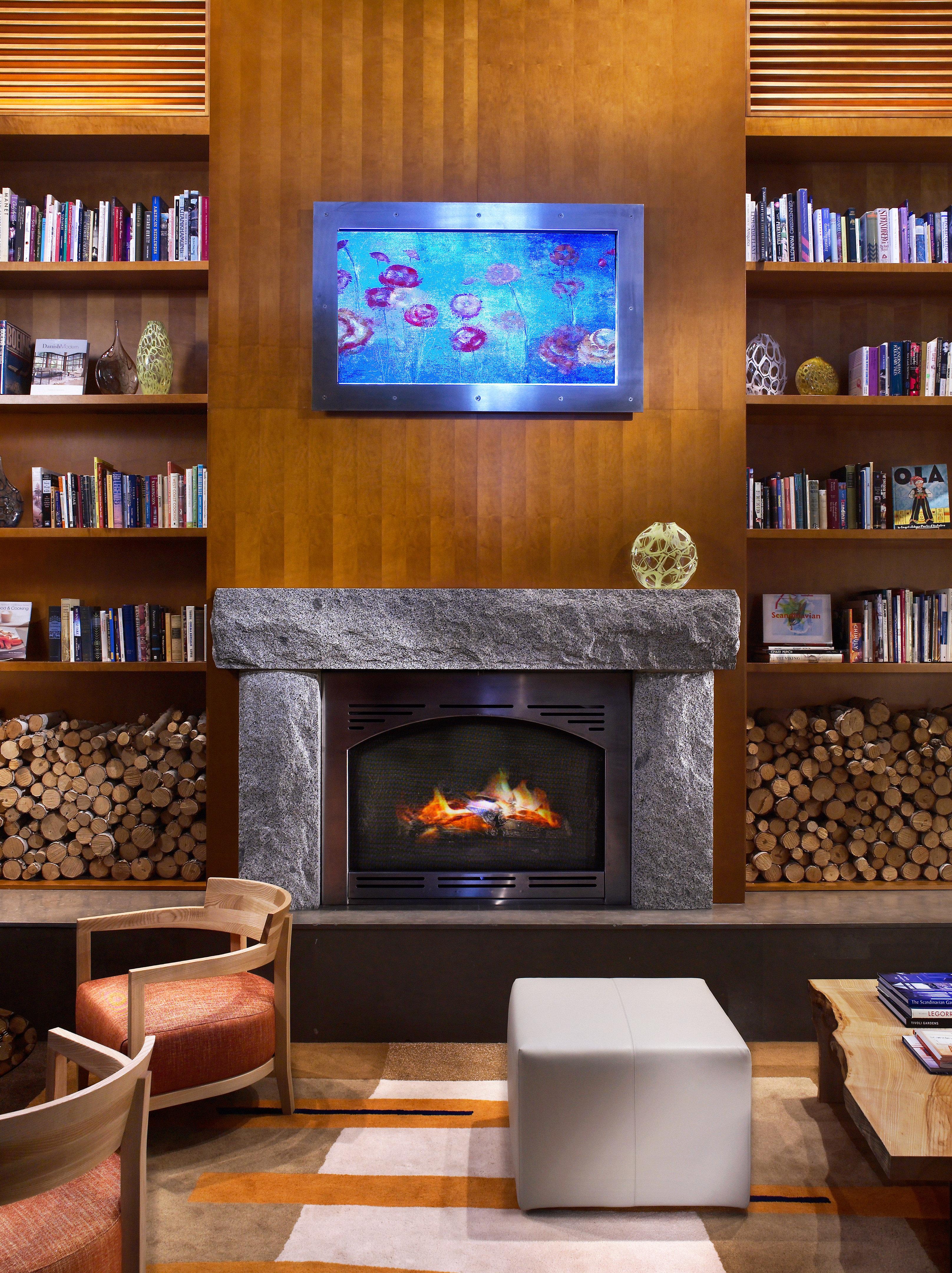 Budget City Fireplace Lobby shelf book living room home hardwood recreation room