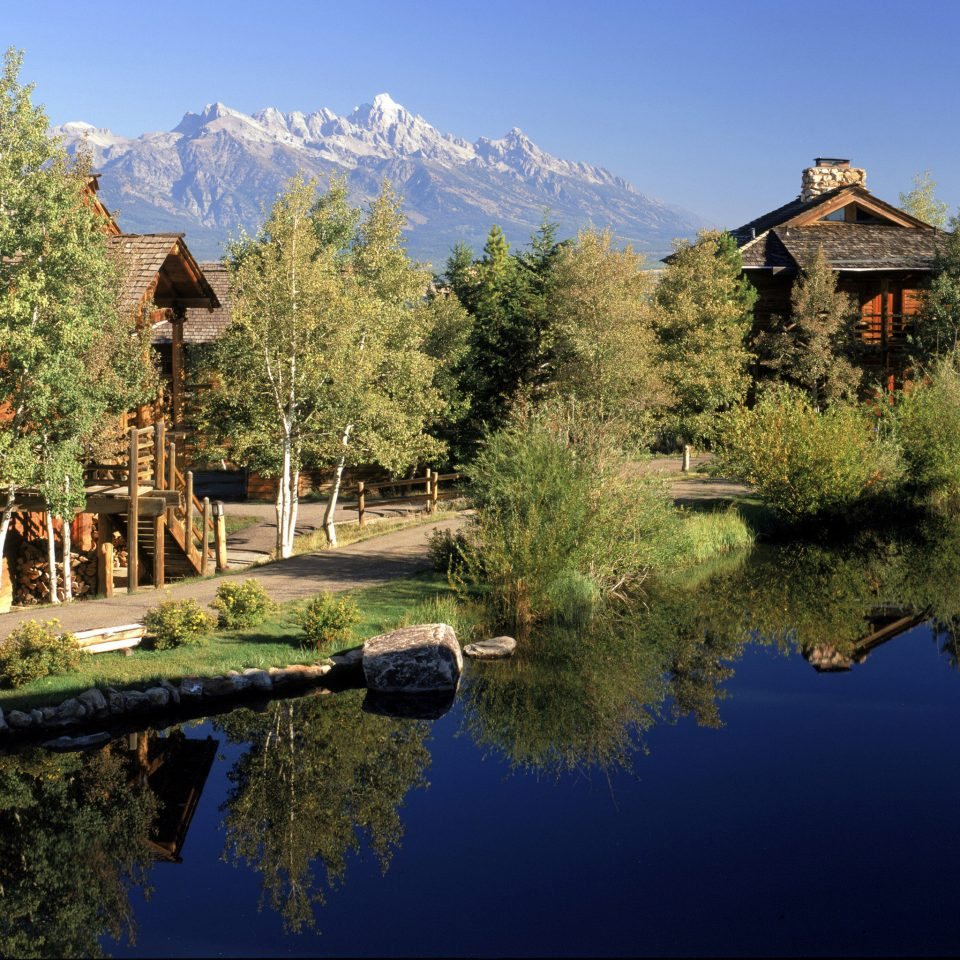 Budget Country Exterior Family Forest Grounds Lake Lodge Mountains Outdoors Scenic views tree sky house wilderness River old pond surrounded château autumn castle