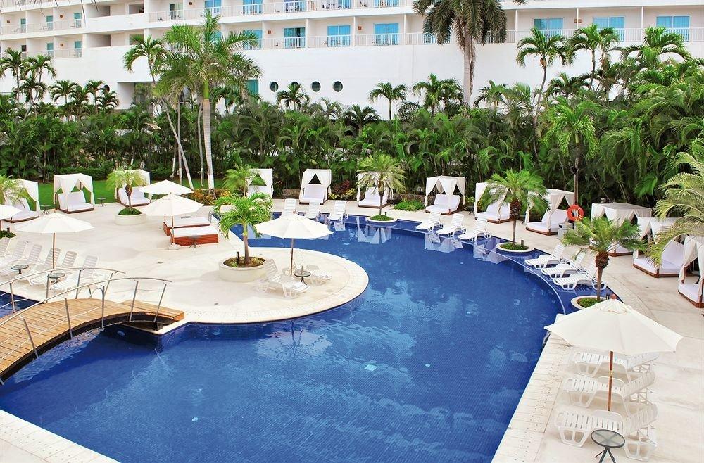 Budget Family Pool Resort Tropical swimming pool leisure property backyard Villa condominium home mansion hacienda Courtyard