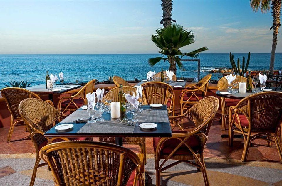 Budget Dining Drink Eat Resort Scenic views Tropical Waterfront sky water chair umbrella leisure restaurant caribbean Villa shore Deck set