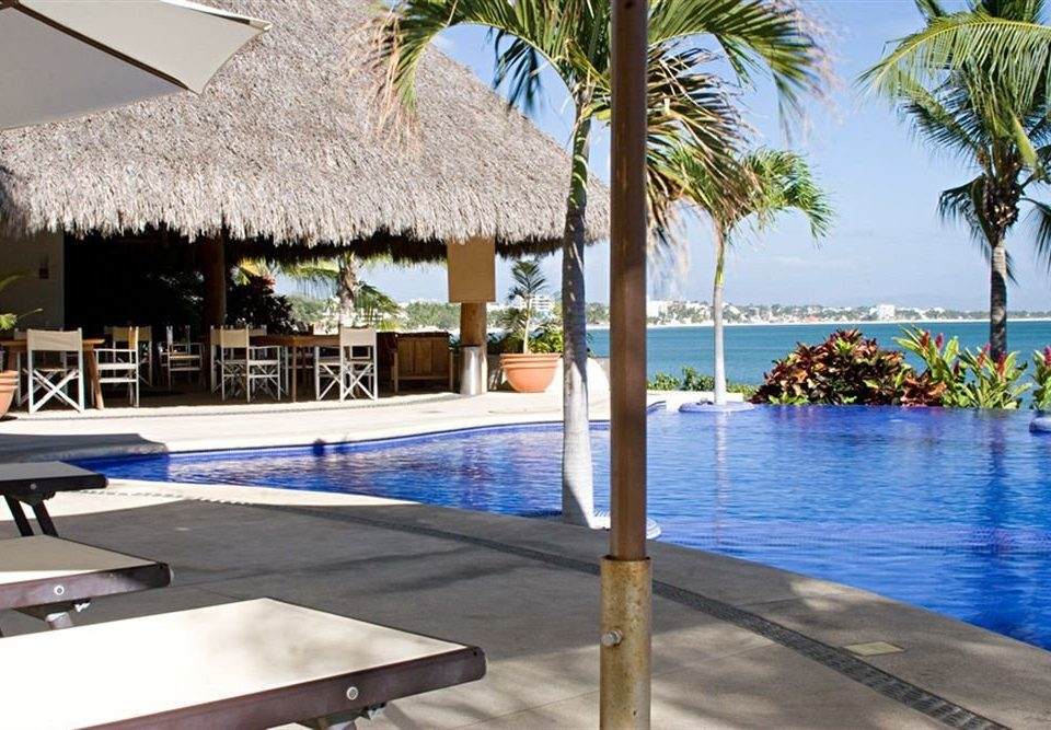 Budget Family Pool Tropical water leisure swimming pool property Resort Villa caribbean condominium palm lined shore