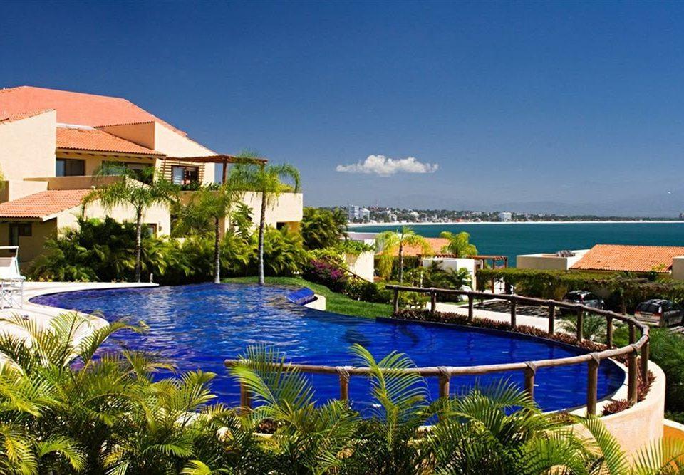 Budget Family Pool Tropical sky water swimming pool leisure property Resort Villa condominium caribbean resort town home marina blue colorful