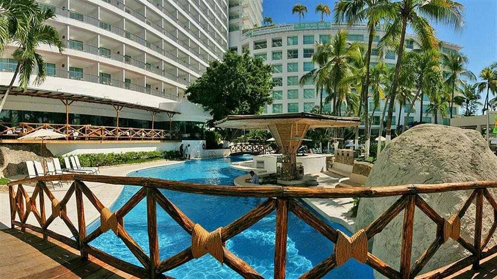 Budget Family Pool Resort Tropical tree leisure swimming pool building condominium