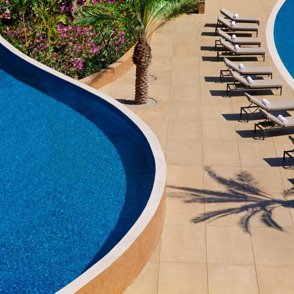 Budget Hotels blue swimming pool flooring walkway