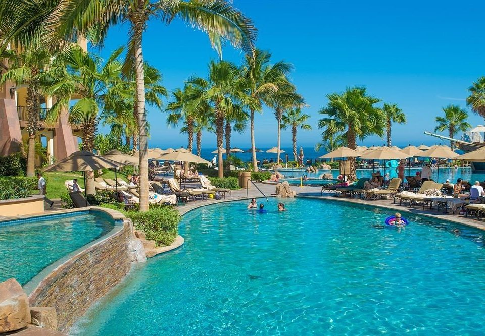 Budget Pool Resort Tropical Waterfront tree water sky swimming pool property leisure caribbean swimming Lagoon palm resort town Water park Villa blue surrounded lined