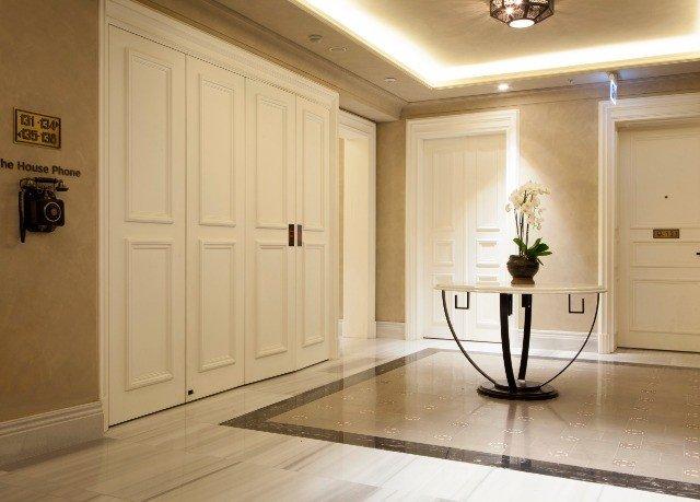 building property cabinetry hardwood home flooring wood flooring hall lighting door living room