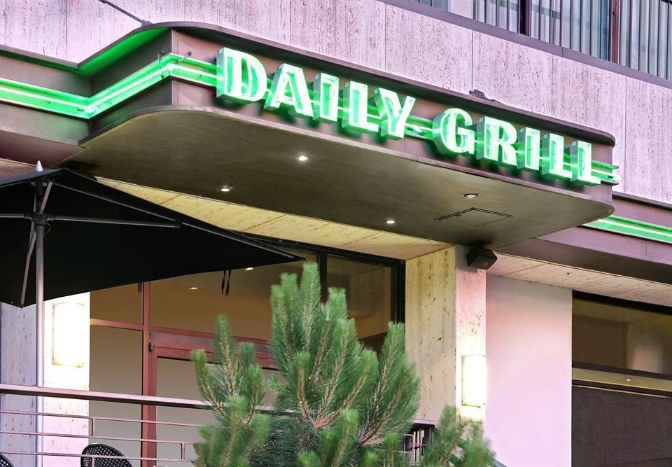 building green canopy signage restaurant