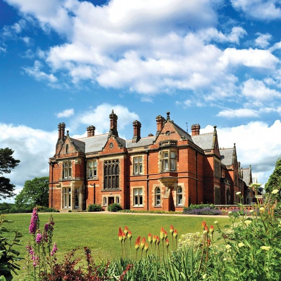 sky grass house building château stately home home rural area residential area manor house mansion old castle lush day